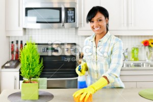 stock-photo-16313427-young-woman-cleaning-kitchen